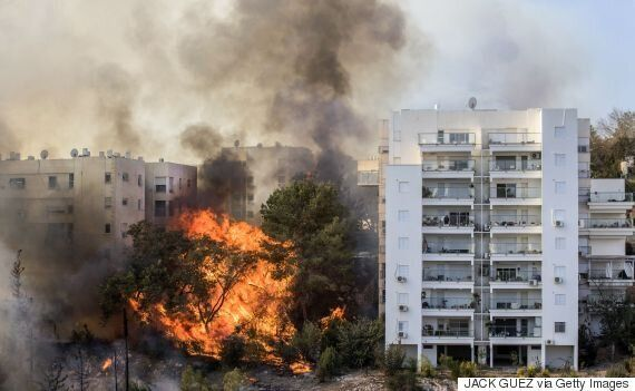 Εικόνες καταστροφής στο Ισραήλ. Μάχη με τις φλόγες σε 11