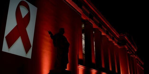 The National and Kapodistrian University of Athens is illuminated with a red light by the Hellenic Center...