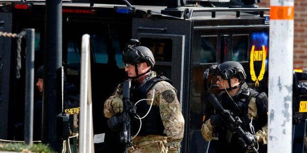 Law enforcement officials are seen outside of a parking garage on the campus of Ohio State University...