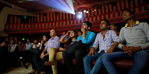 Cinema goers watch Bollywood