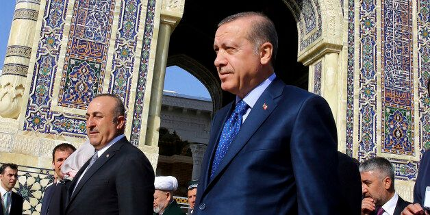 Turkey's President Recep Tayyip Erdogan, front, visit the mausoleum of Imam Bukhari, one of most respected...