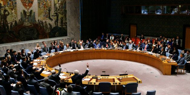 Members of the United Nations Security Council vote to adopt a resolution regarding the Comprehensive...