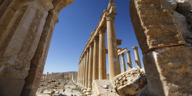 A view shows the damage at the Monumental Arch in the historical city of Palmyra, in Homs Governorate,...