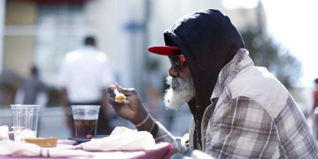 A man eats an early Thanksgiving meal served to the homeless at the Los Angeles Mission in Los Angeles,...