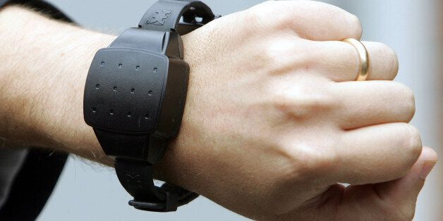 An electronic bracelet is seen in the minimum-security center of Haubourdin, in the suburbs of Lille,...