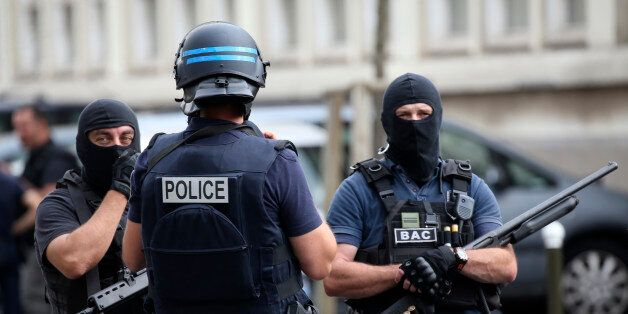 French police and anti-crime brigade (BAC) secure a street they carried out a counter-terrorism swoop...