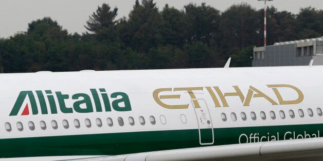 Alitalia plane waits on the tarmac prior to take off from the Malpensa international airport, in Milan,...
