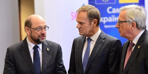 European Parliament President Martin Schulz (L) speaks with European Council President Donald Tusk (C)...