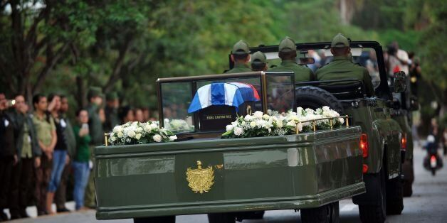 The urn with the ashes of Cuban leader Fidel Castro is driven through Santa Clara, Cuba, on December...