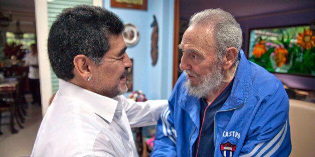 Cuba's Fidel Castro shakes hands with former soccer star Diego Maradona in Havana, Cuba, Saturday, April...