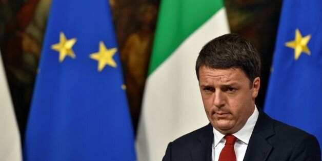 Italian Prime Minister Matteo Renzi reacts during a joint press conference with Italian Minister of Economy...