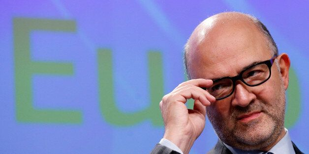European Economic and Financial Affairs Commissioner Pierre Moscovici addresses a news conference at...