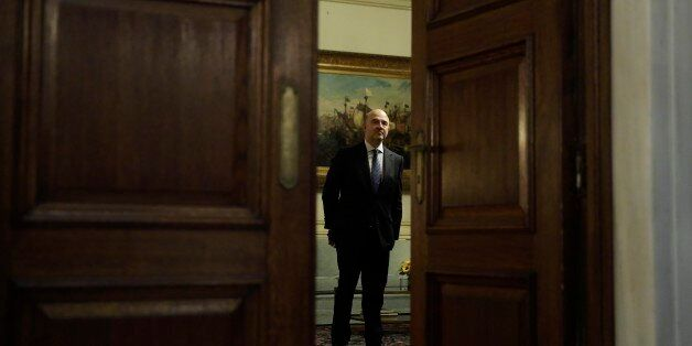 European Commissioner for Economic and Financial Affairs Pierre Moscovici stands before a meeting with...