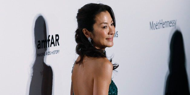 Malaysian actress Michelle Yeoh poses on the red carpet for the fundraising gala organized by amfAR (The...