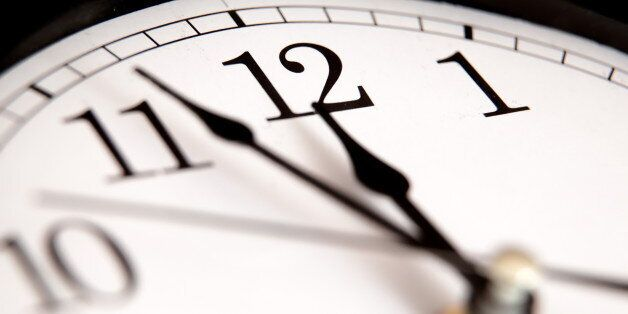 Closeup of hands on clock
