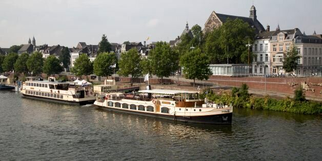 Tourist boats on the river Maas or Meuse, Maastricht, Limburg province,