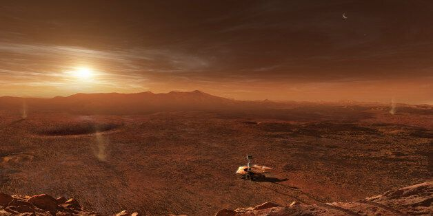 The Mars Exploration Rover Spirit is dwarfed by the desolate Martian desert in Gusev Crater as she makes...
