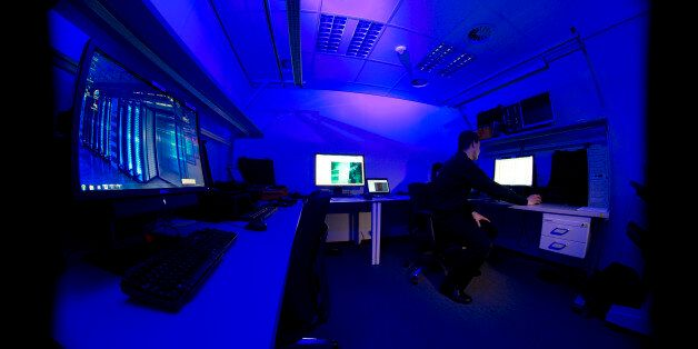 A member of the cybercrime center operates a computer in a lab during a media tour on the occasion of...