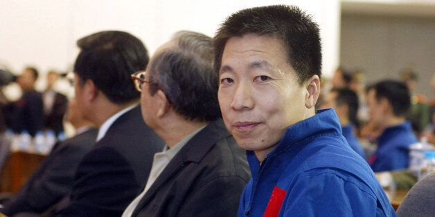 China's first astronaut Yang Liwei (R) attends a ceremony celebratingthe return of the Shenzhou 5 capsule...