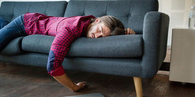 Young man sleeping on sofa with