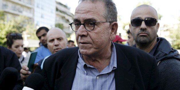 Greek Migration Minister Yannis Mouzalas talks to the media at central Athens's Victoria Square, where...