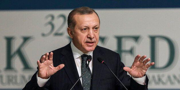 Turkey's President Recep Tayyip Erdogan addresses an annual economy and trade meeting of the Organization...
