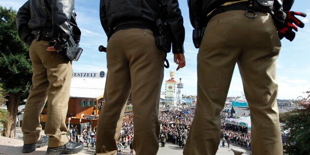 Police officers watch the crowd at the Oktoberfest beer festival in Munich, southern Germany, Sunday,...