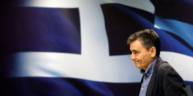 Greek Finance Minister Euclid Tsakalotos arrives for a news conference at the ministry in Athens, Greece...
