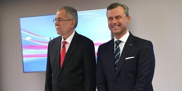 Austrian Presidential election candidates Alexander van der Bellen (L) and Norbert Hofer arrive for the...