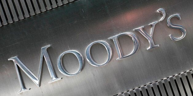 FILE - This August 2010 file photo shows a sign for Moody's Corp. in New York. Moody's is expected to...