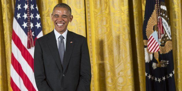 US President Barack Obama laughs while presenting the 2015 National Medal of Arts and 2015 National Humanities...