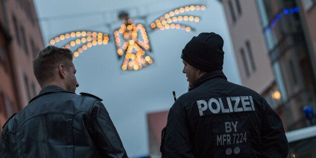NUREMBERG, GERMANY - NOVEMBER 25: Police stand guard at the 2016 Nuremberg Christmas Market on its opening...