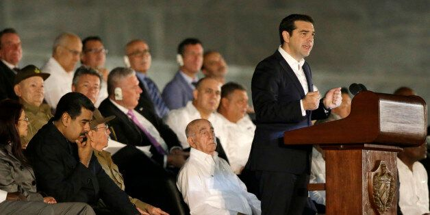 Greek Prime Minister Alexis Tsipras delivers a speech during a rally honoring Fidel Castro at the Revolution...