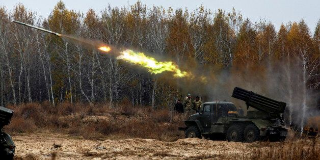 Ukrainian servicemen fire BM-21 Grad multiple rocket launcher systems during military exercises near...