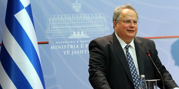 Greek Foreign Minister, Nikos Kotzias speaks at a news conference while hundreds of the Cham community...