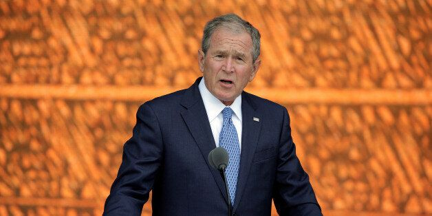 Former U.S. President George W. Bush speaks during the dedication of the Smithsonian's National Museum...