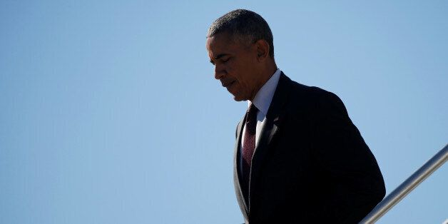 U.S. President Barack Obama arrives aboard Air Force One, en route to a nearby campaign event, at Pope...