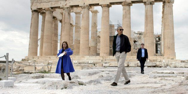 US President Barack Obama (R) walks in front of the Parthenon during a tour of the Acropolis on November...