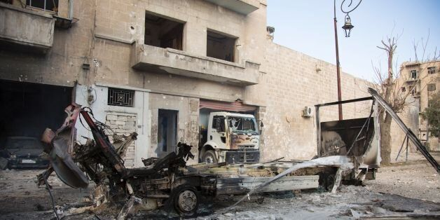 The wreackage of vehicles are seen outside a civil defence centre in Aleppo's rebel-held neighbourhood...