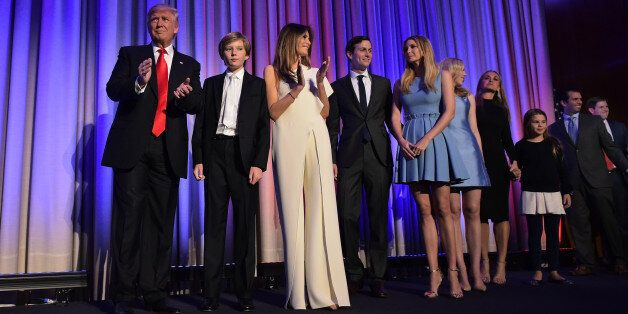 Republican presidential elect Donald Trump arrives with his family on stage to speak during election...