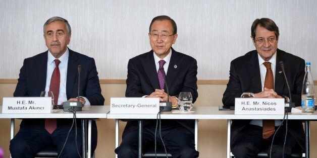 U.N. Secretary-General Ban Ki-moon (C), Turkish Cypriot leader Mustafa Akinci (L) and Cypriot President...