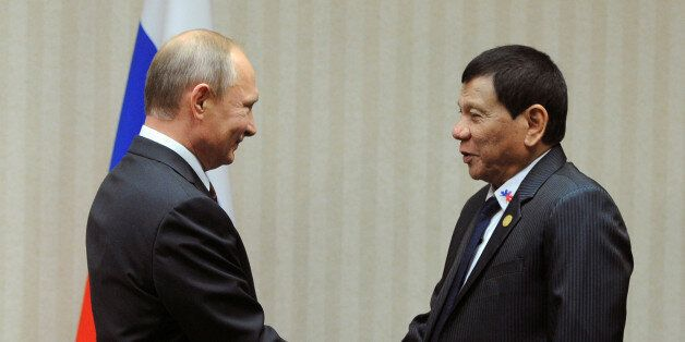 Russian President Vladimir Putin and Philippine President Rodrigo Duterte attend a meeting on the sidelines...