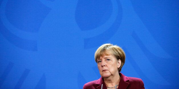 German Chancellor Angela Merkel looks on during a joint news conference with Spain's Prime Minister Mariano...