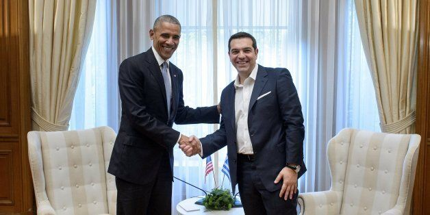 Greek Prime Minister Alexis Tsipras (R) shakes hands with US President Barack Obama prior to their meeting...
