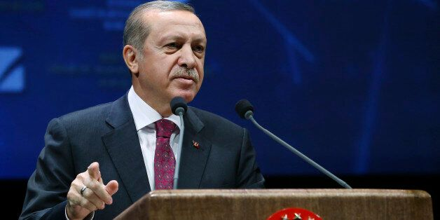 Turkey's President Recep Tayyip Erdogan addresses an energy meeting in his palace in Ankara, Turkey,...