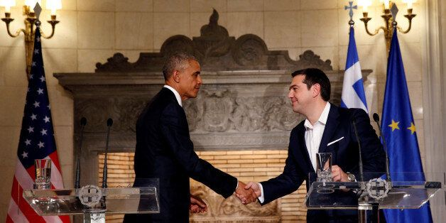 U.S. President Barack Obama and Greek Prime Minister Alexis Tsipras shake hands at the end of a press...