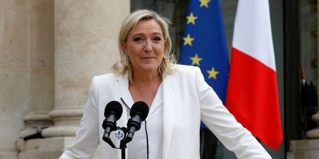 Marine Le Pen, France's far-right National Front political party leader, talks to journalists following...