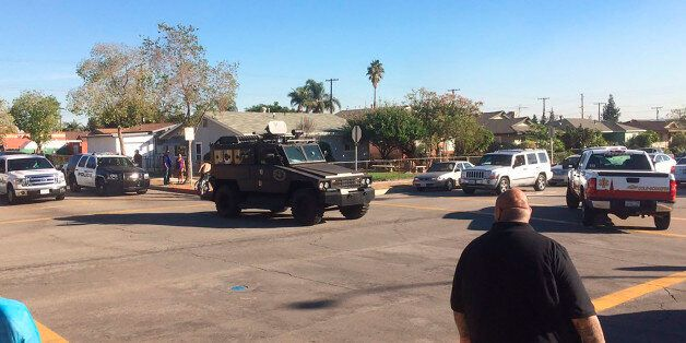 This photo provided by Marco Soto shows police vehicles outside a middle school in Asuza, Calif., on...