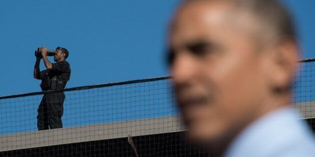 A Secret Service agent keeps watch as US President Barack Obama speaks at a rally for Democratic presidential...