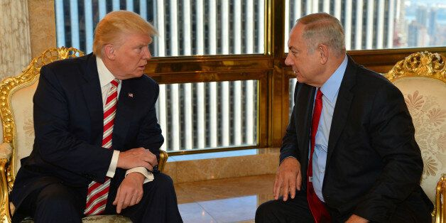 Israeli Prime Minister Benjamin Netanyahu (R) speaks to Republican U.S. presidential candidate Donald...